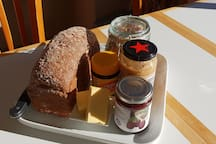 Breakfast of bread, spreads, muesli and yoghurt provided for all guests.