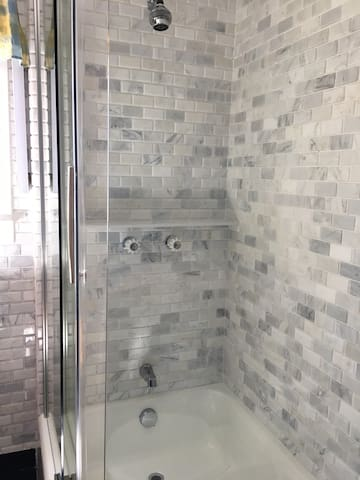 The March 2017 renovation of the bathroom resulted in a large shower area with a cast-iron mini tub that keeps the water hot.