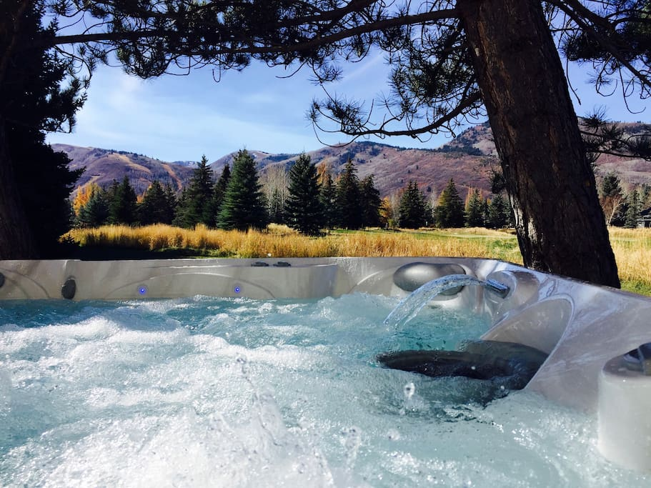 Brand New 7-Person Hot Tub with unbelievable ski mountain views situated VERY PRIVATELY overlooking the golf course