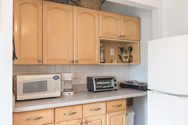 Kitchenette with cooking appliances.