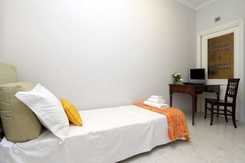 The small room with a single bed