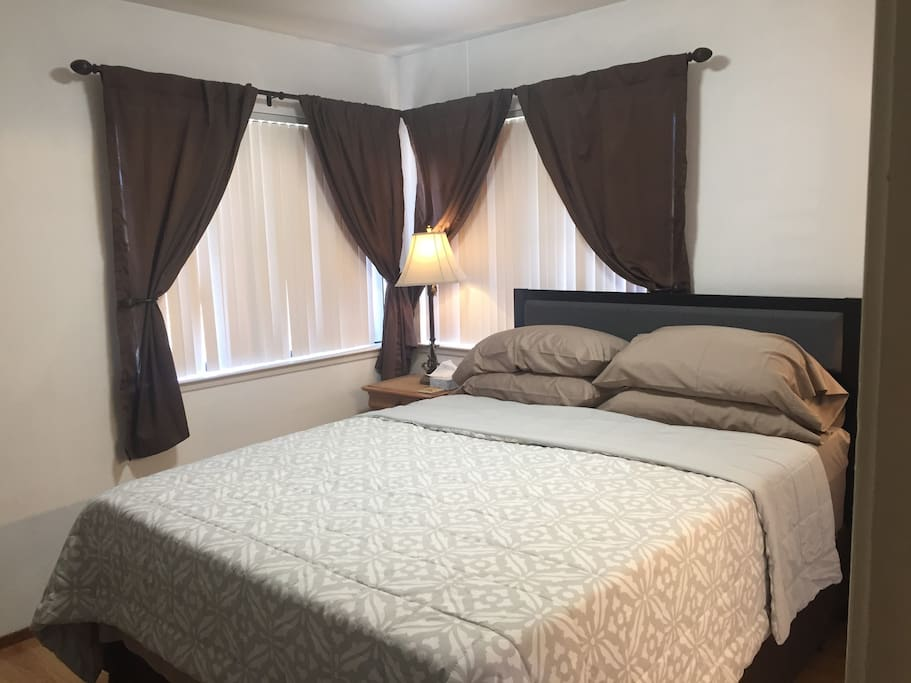 The room has room-darkening vertical blinds and dark curtains. The Queen-size bed is extra soft because of an additional 3-inch thick memory foam on top.