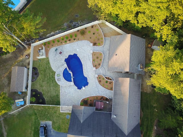 Aerial view of pool, pool house and guest quarters