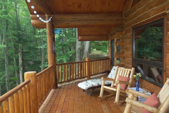 Delightful riverfront cabin w/ wood-burning fireplace and private gas grill!