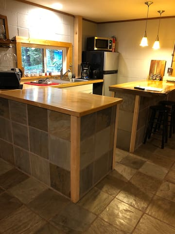 New kitchenette with custom wood counters.