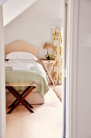 The Yellow Room -set up as a twin. There is an ensuite bathroom with loo, basin and shower.