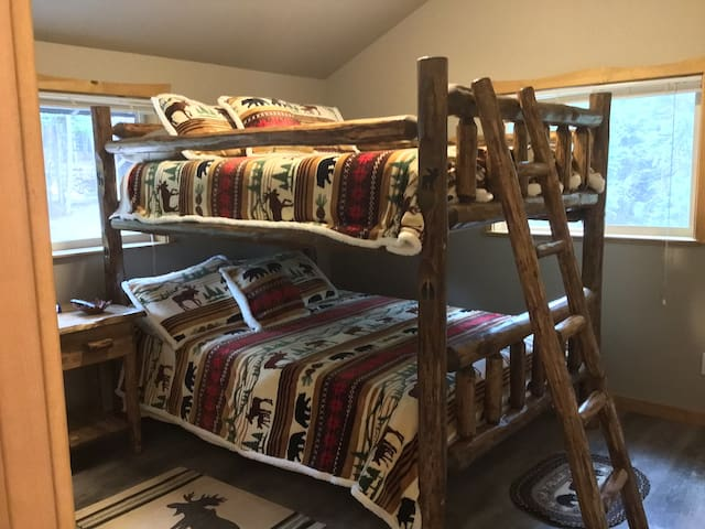 Double Queen bunk bed in nice size room.  New bedding in the Montana way!