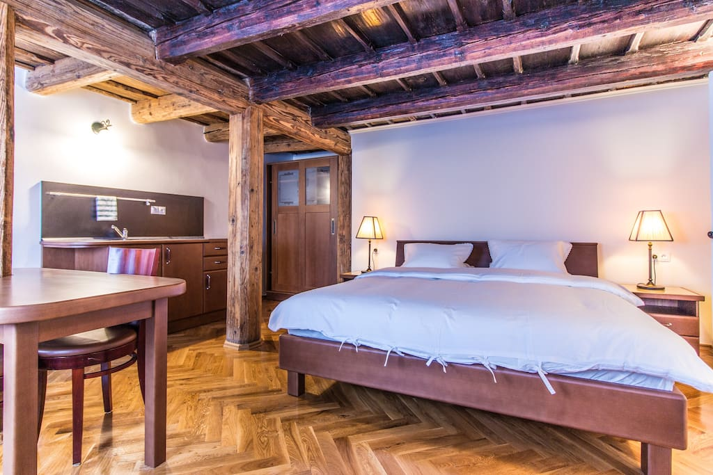 Wooden beams and queen sized bed