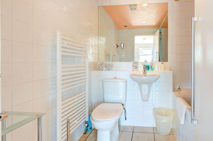Heated towel-rail and heated floor