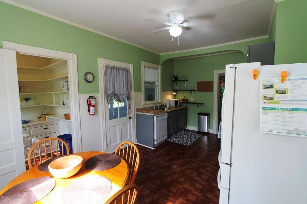 Large eat-in kitchen fully equipped with all needed amenities.