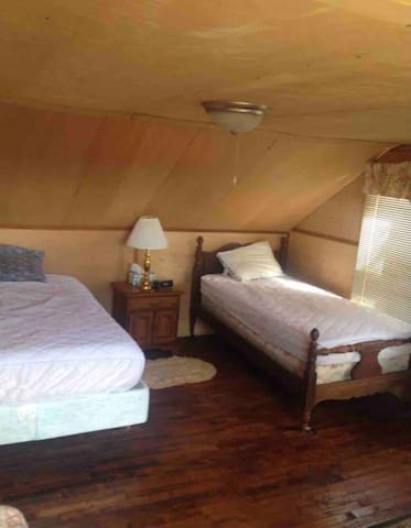 Second bedroom with a queen and a single bed