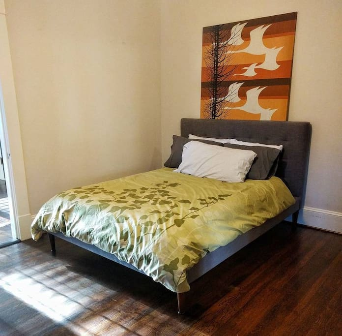 Queen sized bed with memory foam top in the guest bedroom