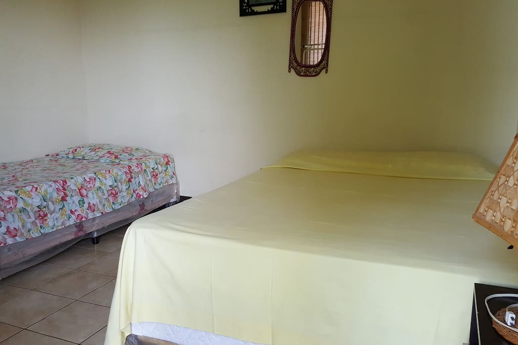 One Queen bed and one single bed, can sleep up to 3 guests.
