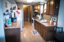 The kitchen is yours to use as you need. Pots & pans and basic cooking essentials are located throughout the cabinets. Enjoy waffles in the morning with the provided mix and waffle iron, or head downtown for countless breakfast options.