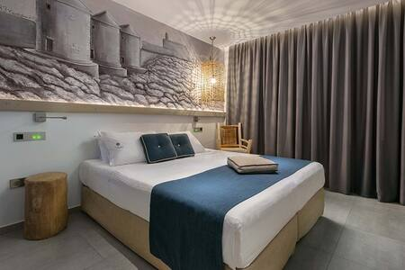 Milos - Bedroom  Located on the third floor of Elakati Luxury Boutique Hotel