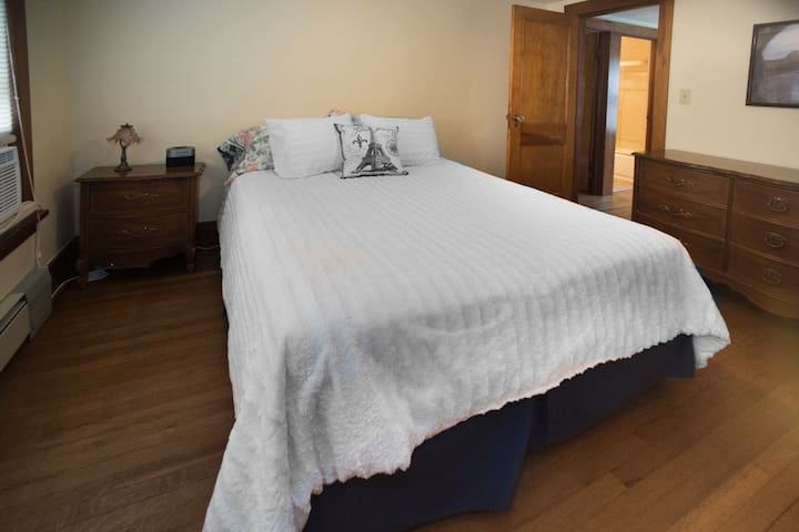Side Bedroom with Queen Size Bed and window AC unit.