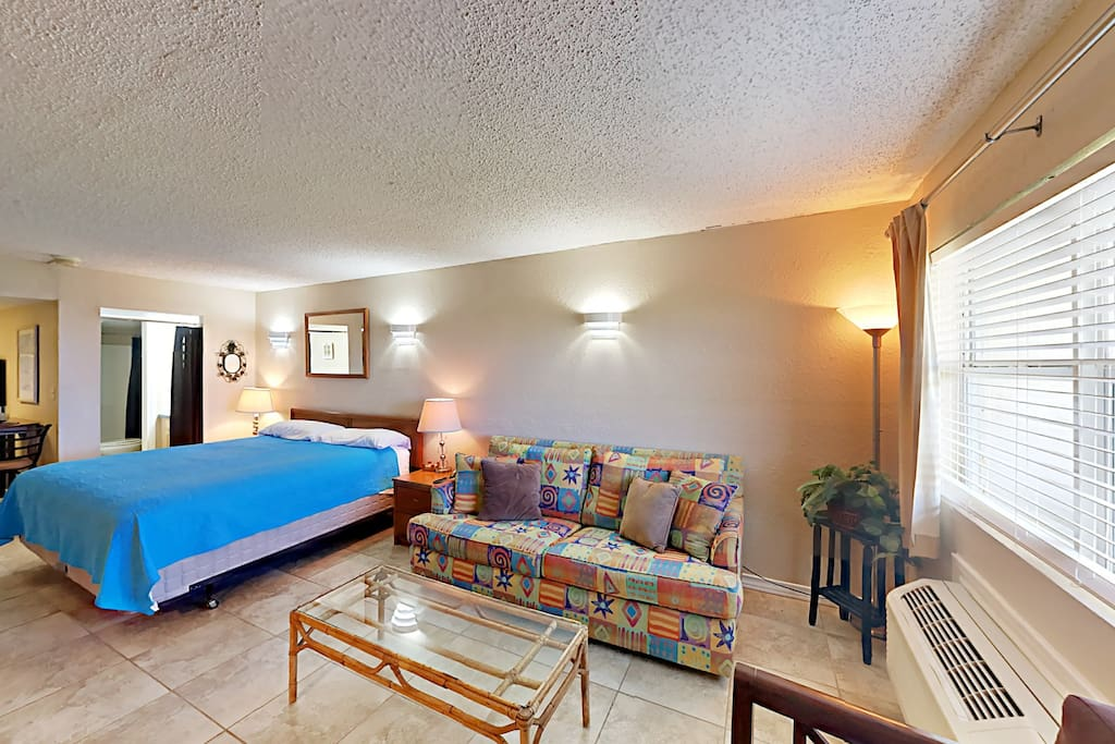 Walk to the beach from this 3rd-floor Port Aransas studio with a full kitchen and private balcony.