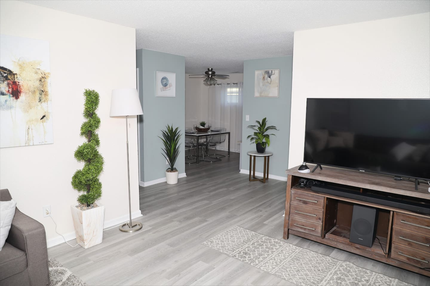 The spacious living room is very comfy and has a large smart TV with high-speed internet