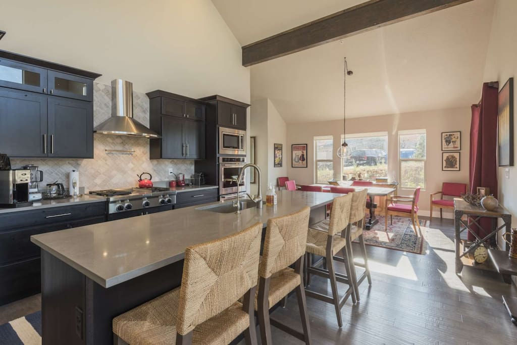 Chef' kitchen is complete with stainless steel appliances (2 ovens, gas stove), slate counters, breakfast bar and lots of counter space.