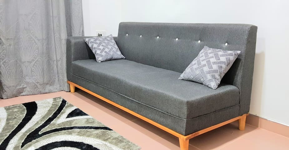 Comfortable Sofa Bed in the Living Room. After a busy day, have some rest while watching your fav show on Netflix or any channel of your choice from cable TV