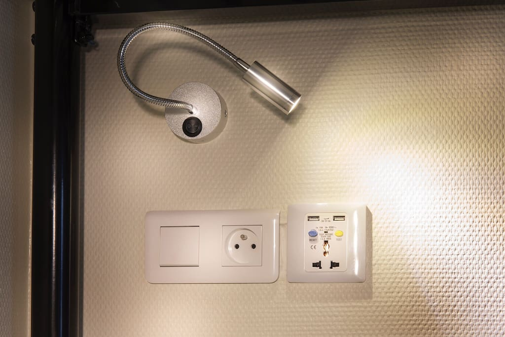 For each bed : Personnal LED light + international power plug