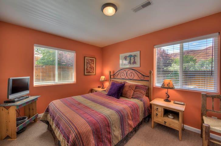 Lots of light in this Queen Bedroom