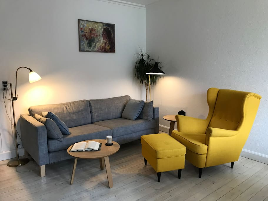 Comfortable chair and a sofa in the living room. You can relax here after a busy day of sightseeing.