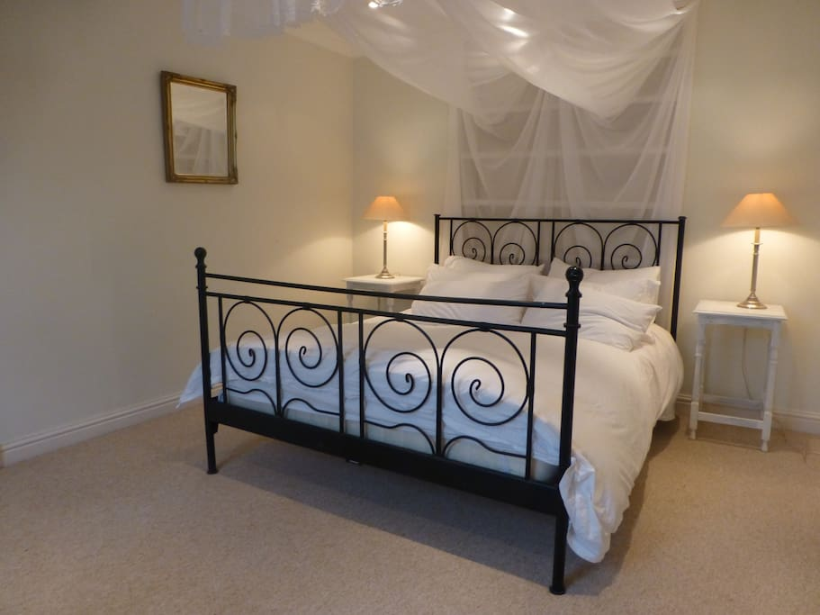 Bedroom One - luxury linen and mountains of pillows for a dreamy night's sleep.  King size bed.
