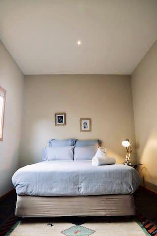 Queen bedroom on bluestone floor