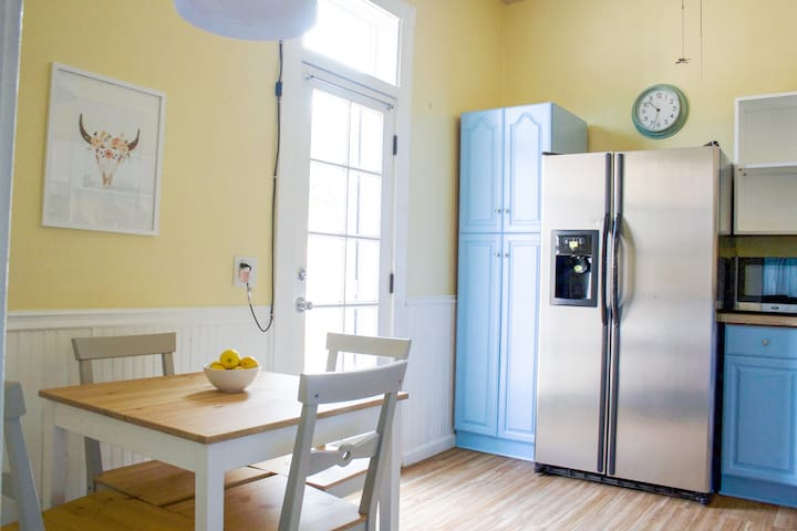 The bright and sunny eat-in kitchen is fully stocked with everything you need to enjoy a meal.