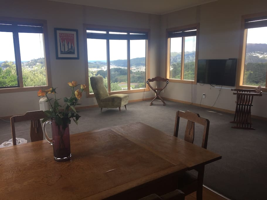 Spacious open plan kitchen, lounge and dining with panoramic views across Cook Strait and Wellington's Green Belt