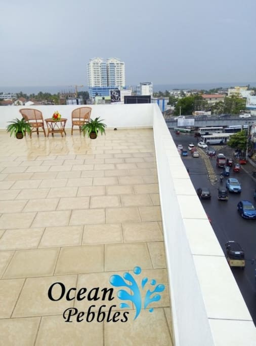 Spacious Ocean Pebbles Roof top Edge view of the Entire City