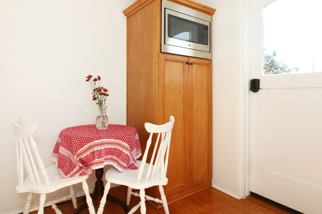 Breakfast nook with microwave in the adjoining shared laundry room.