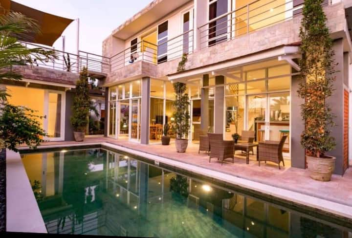 Spacious modern villa with a rooftop yoga terrace.