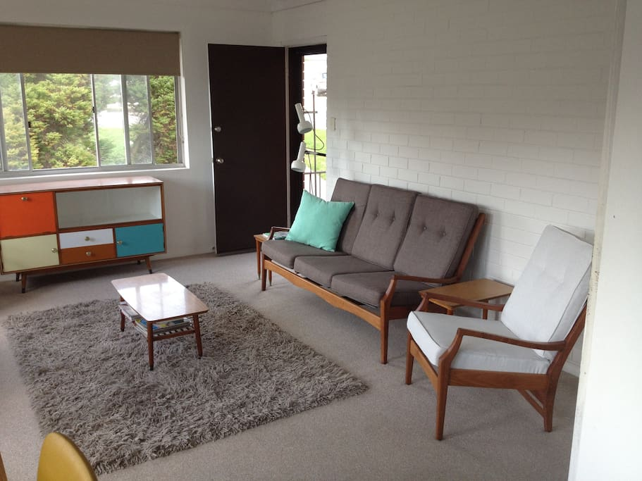 Living area comprises of new mid century furniture.