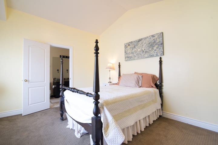 Private room with double bed + attached bathroom.