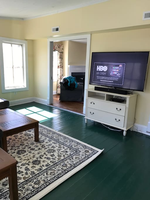 Large sun room with DishTV, Polk Bluetooth sound bar, DVD player and wifi internet access (streaming video access not available; satellite internet connection)