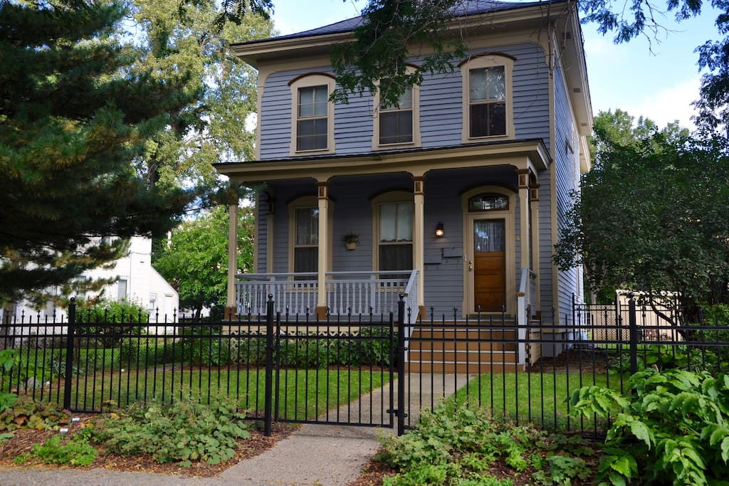 Charming Victorian home with front porch and modern interior furnishings.