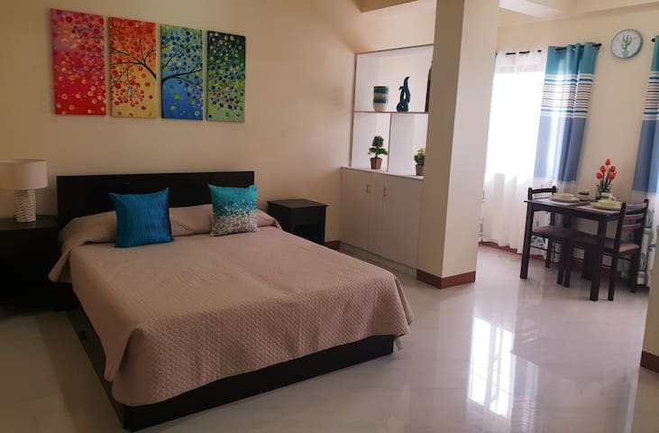 Queen size bed with pull out bed Can accomodate 2-4pax