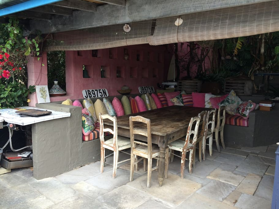 The gorgeous outdoor dining room is sheltered and comfortable and perfect to use all year round. It has 2 high pressure gas wok cooking burners, and a wood-fired pizza oven for outdoor cooking.