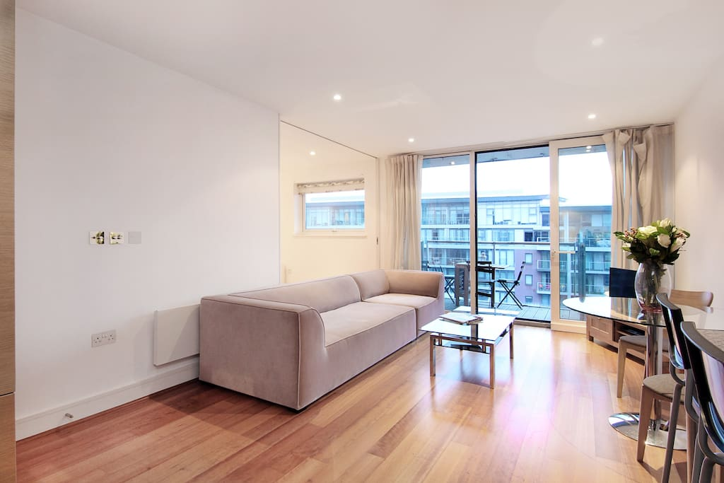The bright lounge and dining area of this apartment looking out towards the private balcony