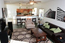 Living room and kitchen are separated by mahogany breakfast bar.