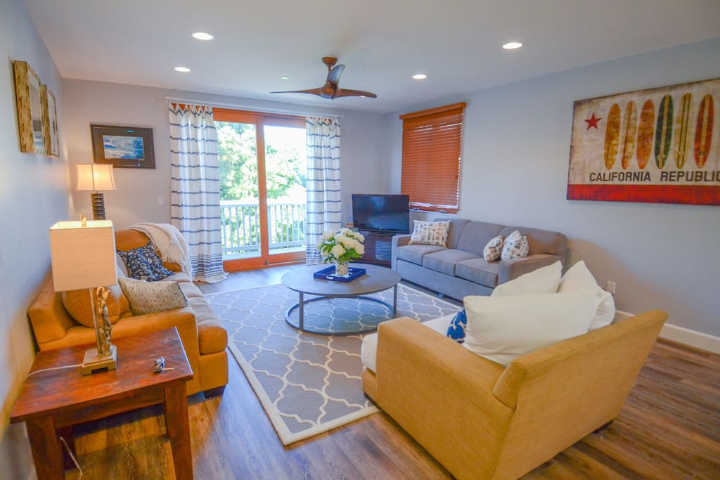 Large gathering room with TV, plenty of comfy seating, including a pull-out sleeper sofa
