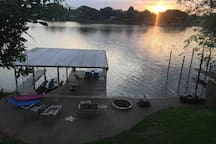 View of covered dock area with firepit & seating to enjoy Lake, fire & views