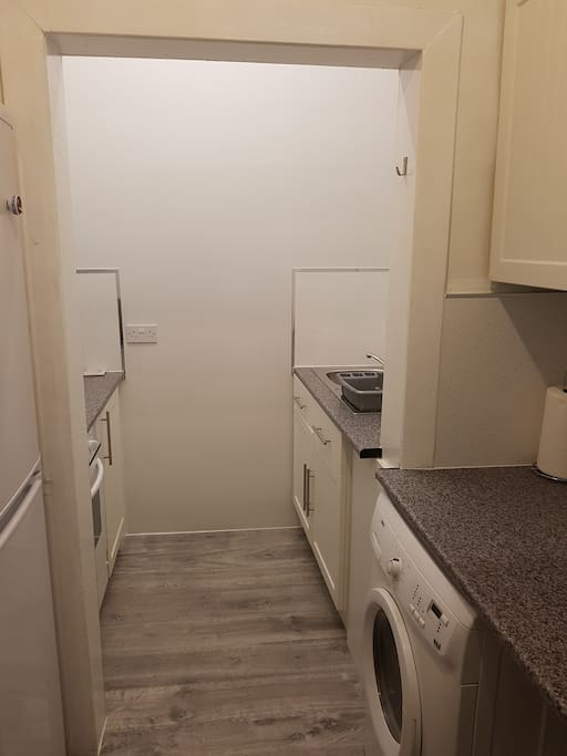 Washing machine,cooker, microwave and crockery all available.