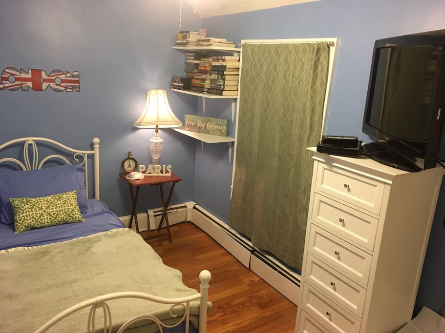 "Your room with bed, 32"" flatscreen tv with bluray player and netflix, tall dresser and shelf"
