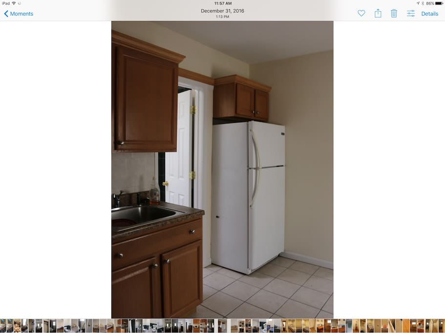 The kitchen has full size fridge, new sink and stove