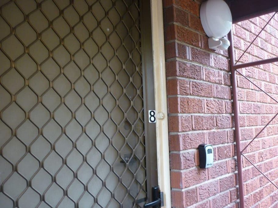 Unit 8 entrance with key lock box & movement sensor light