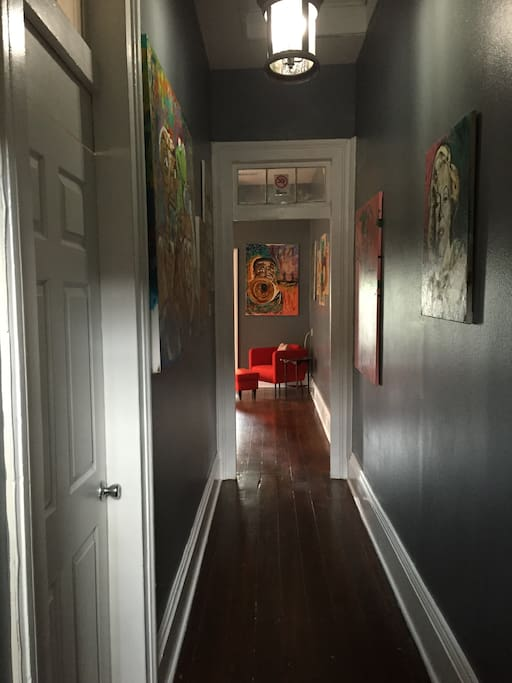 Mini Art Gallery throughout the apartment supporting young local New Orleans artist!