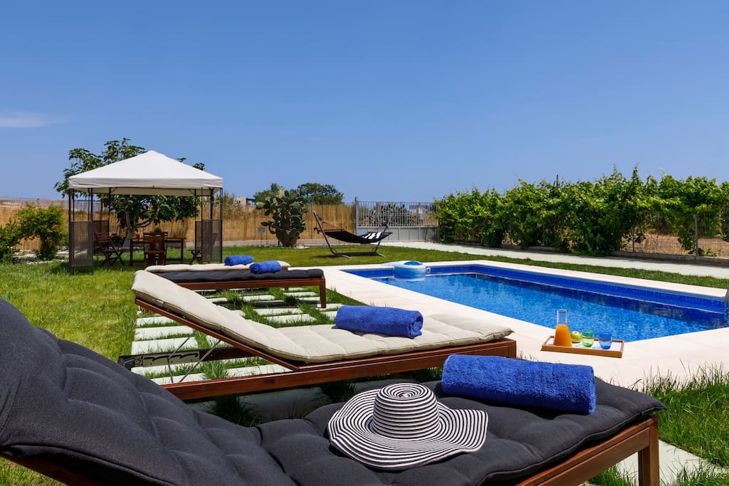 Relax under the Greek sun by the private pool